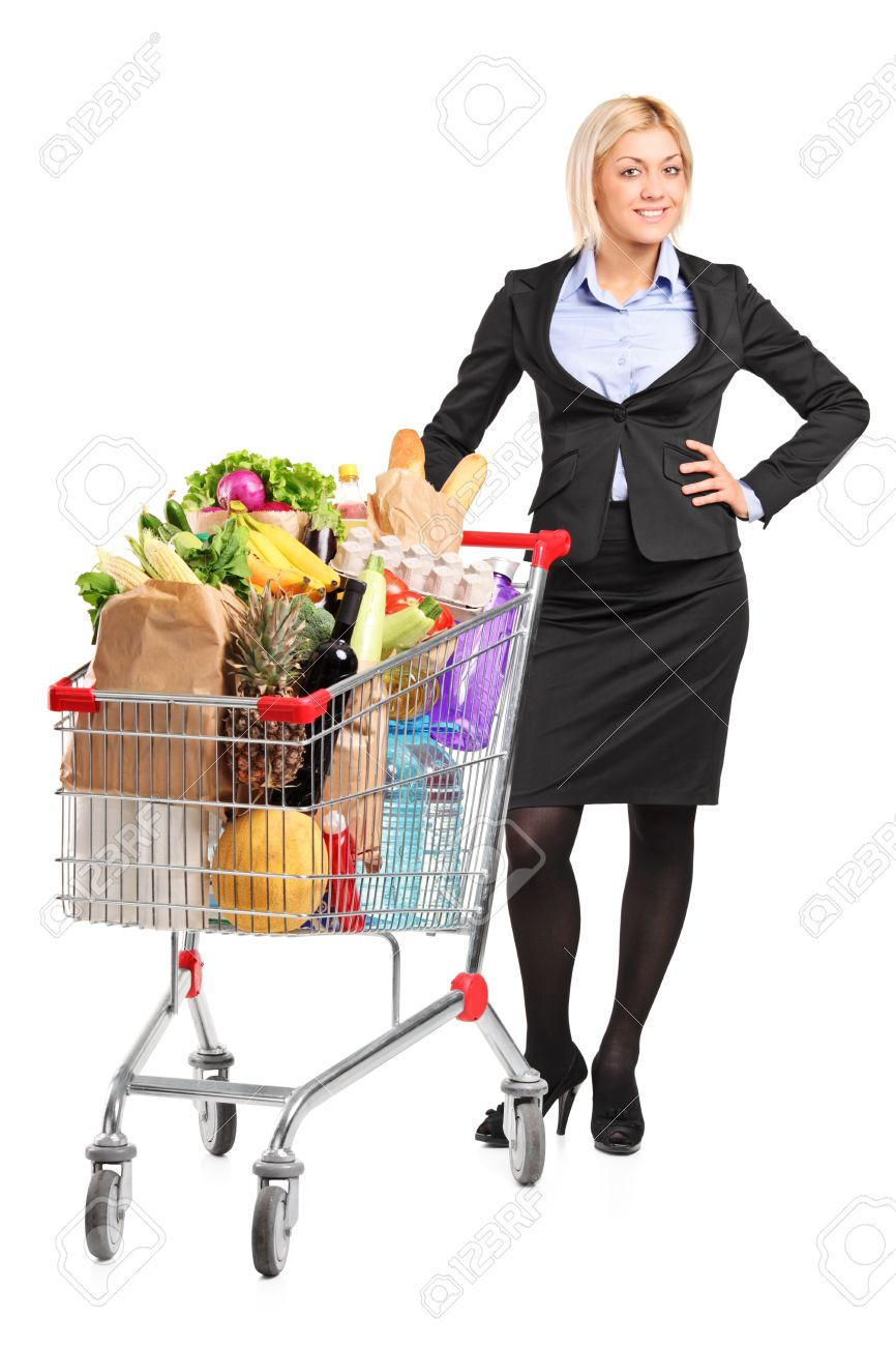 Full length portrait of a young woman posing next to a shopping cart full with groceries isolated on white background Stock Photo - 10105407