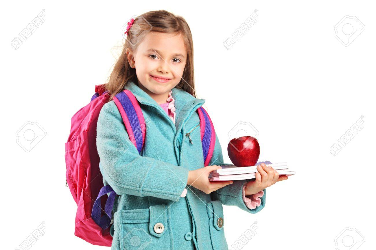 c32de21d6ebf A school girl with backpack holding notebooks and red apple isolated on white  background Stock Photo