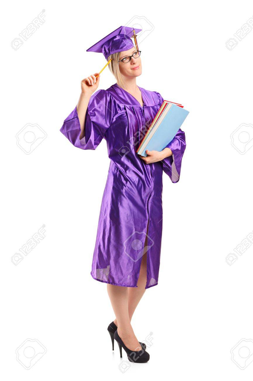 Full length portrait of a graduate student in thoughts holding a book isolated on white background Stock Photo - 10280965