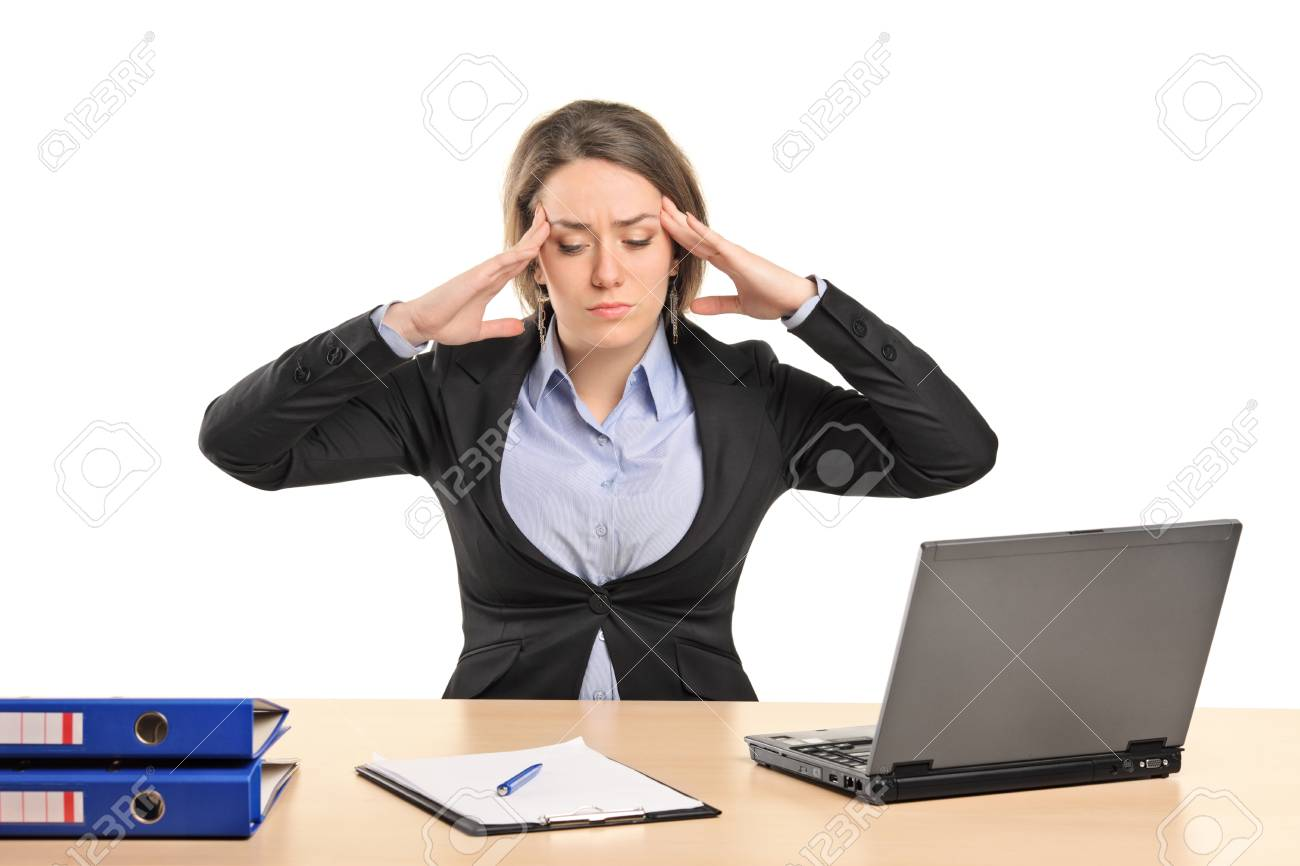 A young businesswoman in pain as a result of a headache posing isolated on white background Stock Photo - 10354261