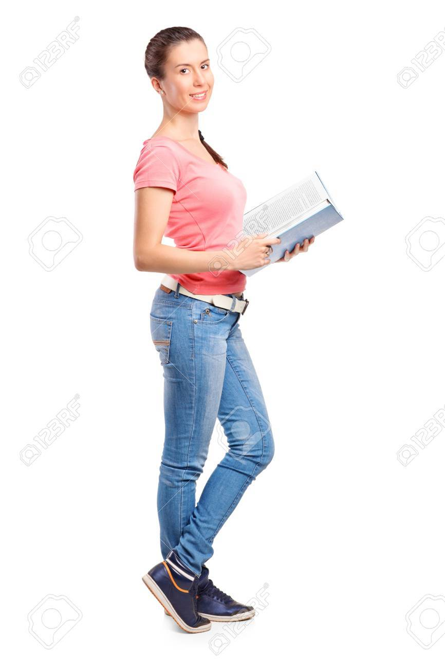 Full length portrait of a school girl holding a book isolated on white background Stock Photo - 10765239
