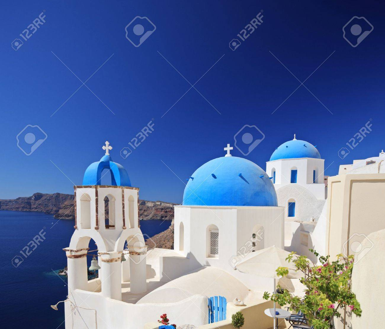 View of blue dome church in Oia village on Santorini island, Greece Stock Photo - 11264760