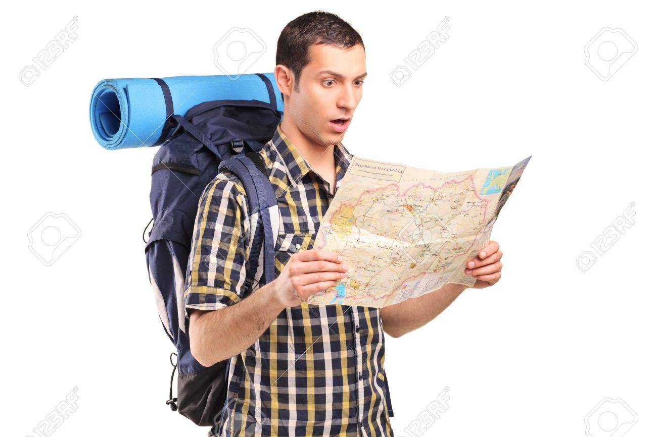 A lost hiker looking at map isolated on white background Stock Photo - 11744279