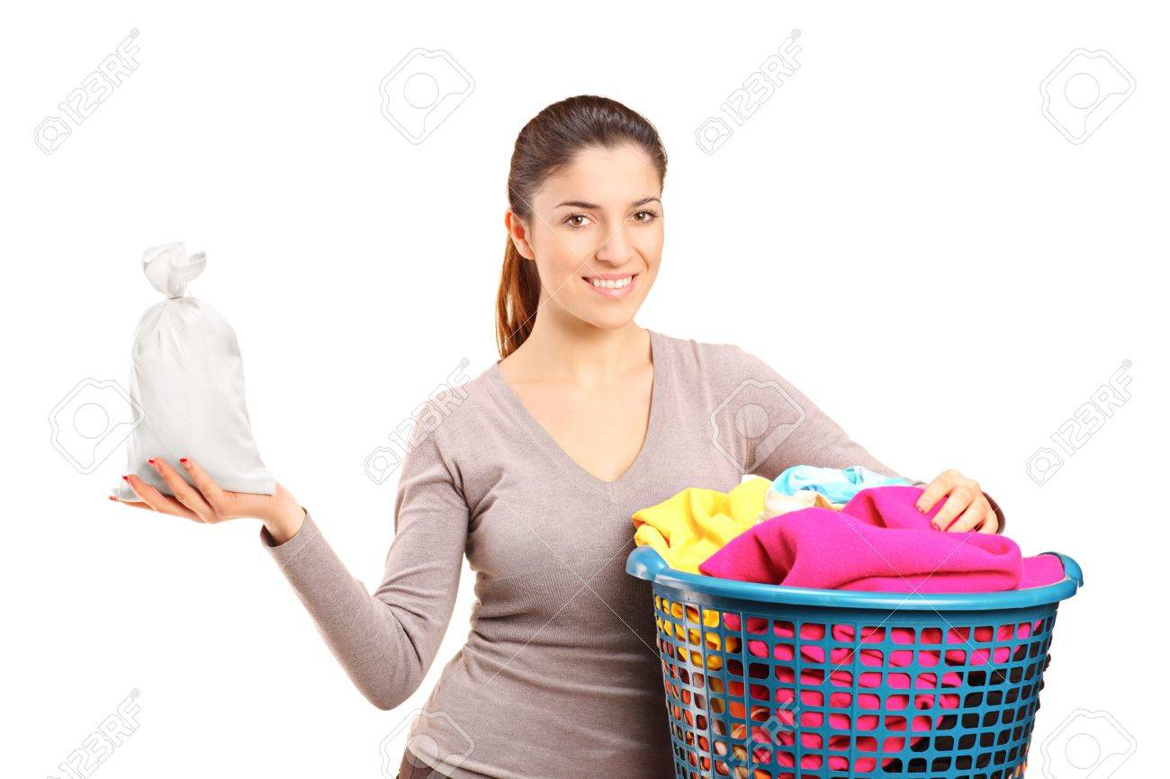 A woman with a laundry basket holding a money bag isolated on white background Stock Photo - 11744375