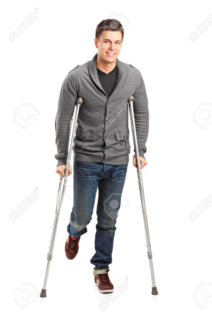 Full length portrait of an injured young man on crutches isolated on white background Stock Photo - 11744372
