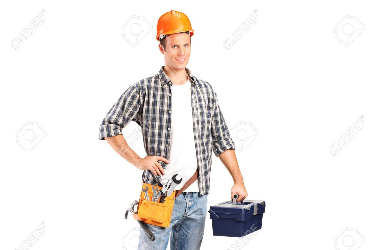 A confident and smiling manual worker holding a wrench and a toolbox isolated on white background Stock Photo - 11744585