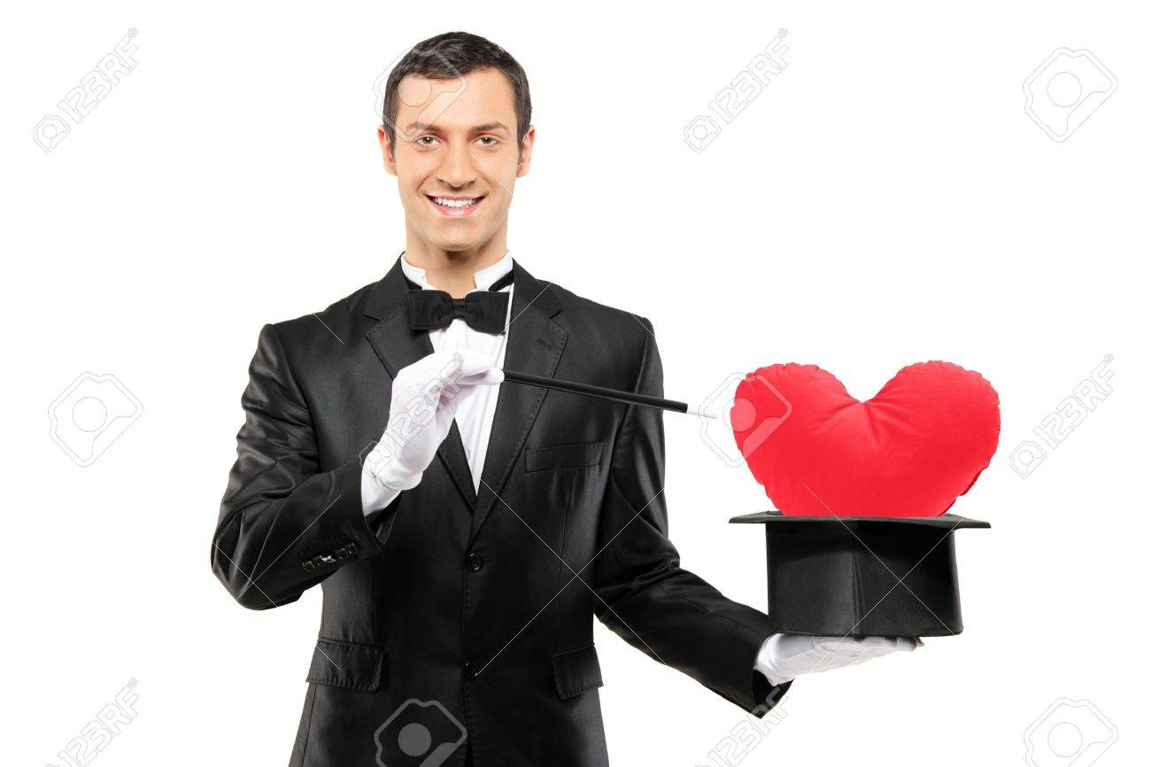 Young Magician Holding A Magic Wand And Top Hat With A Red Heart