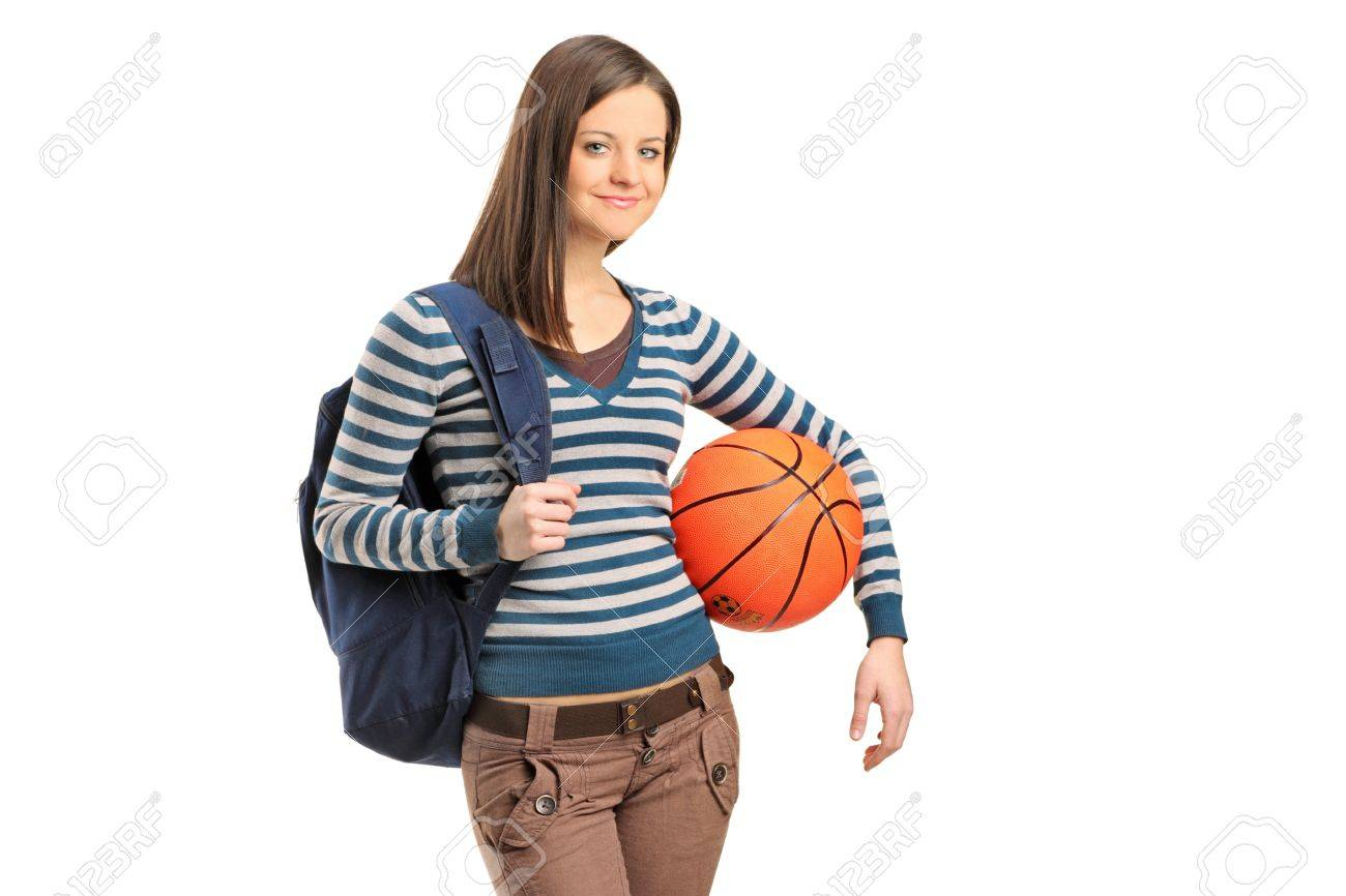 A young school girl holding a basketball isolated on white background Stock Photo - 12181306