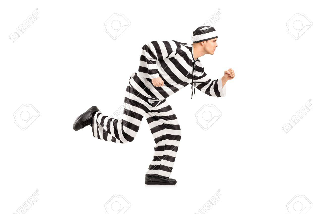 Full length portrait of a prisoner escaping isolated on white background Stock Photo - 12883116