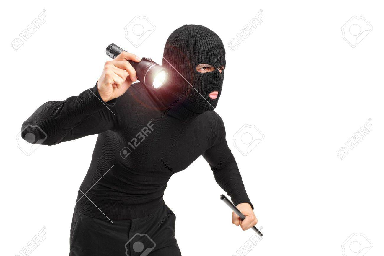 A robber with robbery mask holding a flashlight and piece of pipe isolated on white background Stock Photo - 12883367