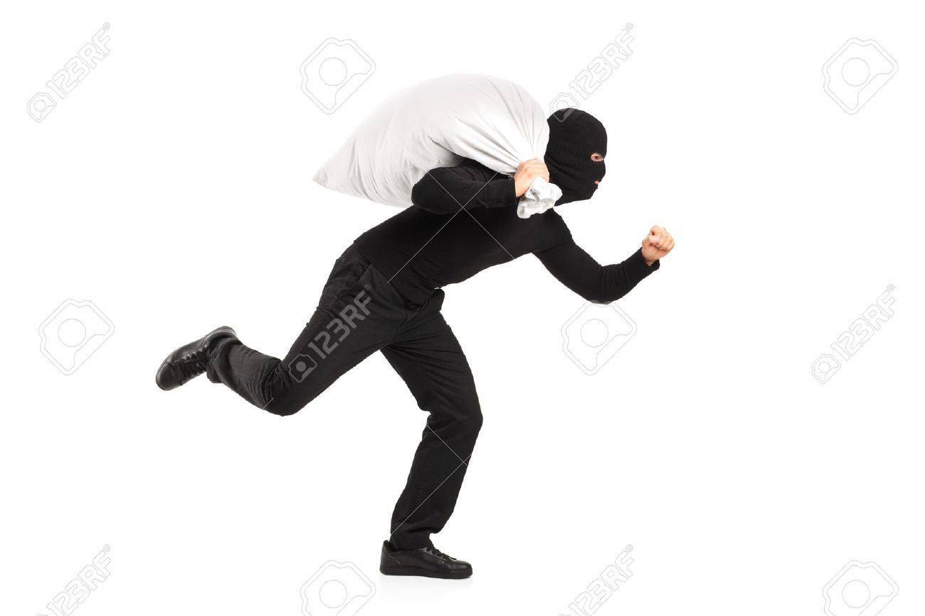 Thief carrying a bag and running away isolated on white background Stock Photo - 13293630