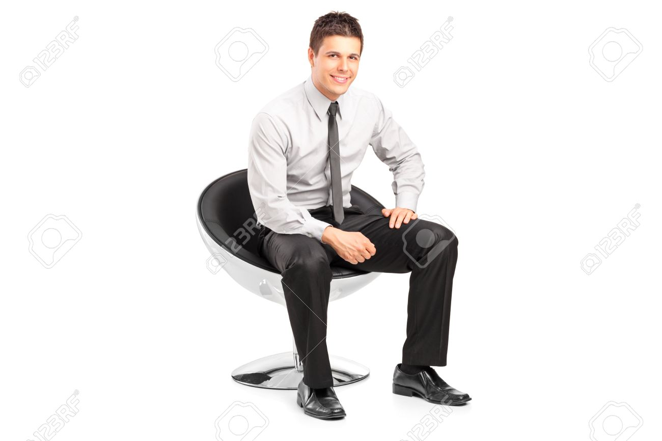 Stupendous A Young Handsome Male Sitting On Chair And Posing Isolated On Caraccident5 Cool Chair Designs And Ideas Caraccident5Info