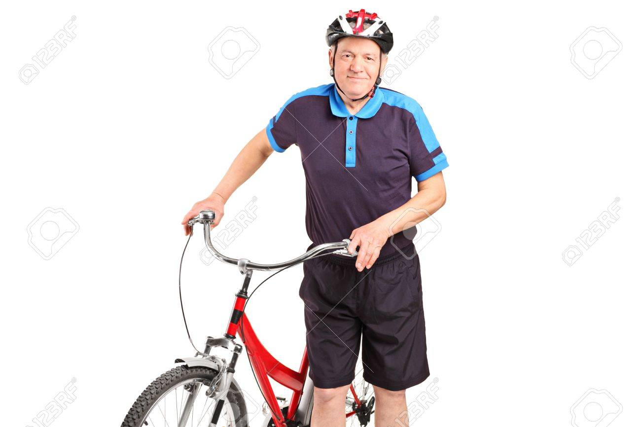 A senior bicyclist posing next to a bicycle isolated on white background Stock Photo - 14286119