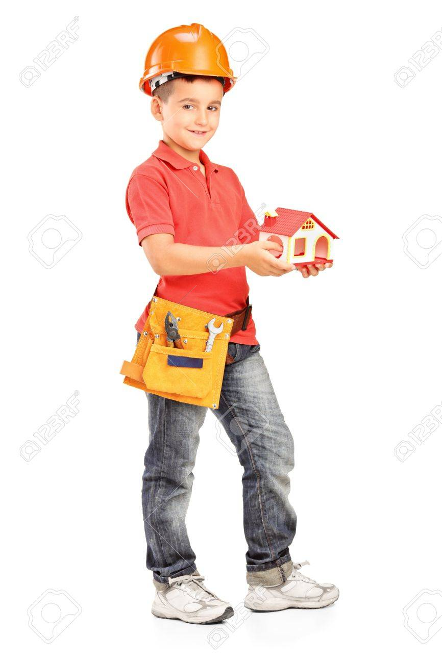 Full length portrait of a child with helmet holding a model of house isolated on white background Stock Photo - 14286186
