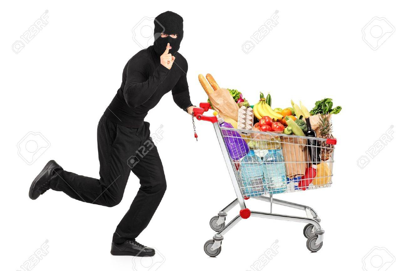 Robber stealing a pushcart with products, isolated on white background Stock Photo - 14549656