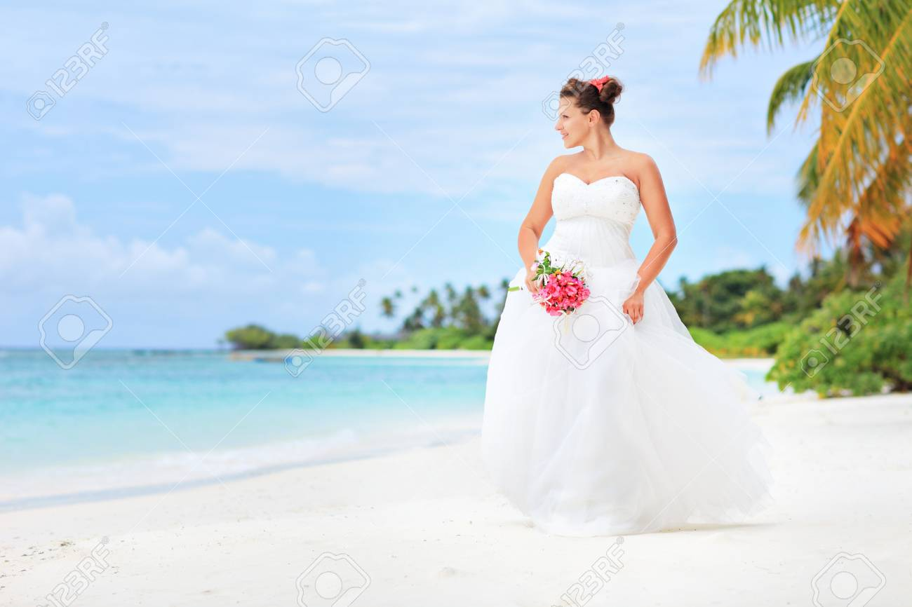 A Bride Posing On A Beach In Kuredu Resort Maldives Island