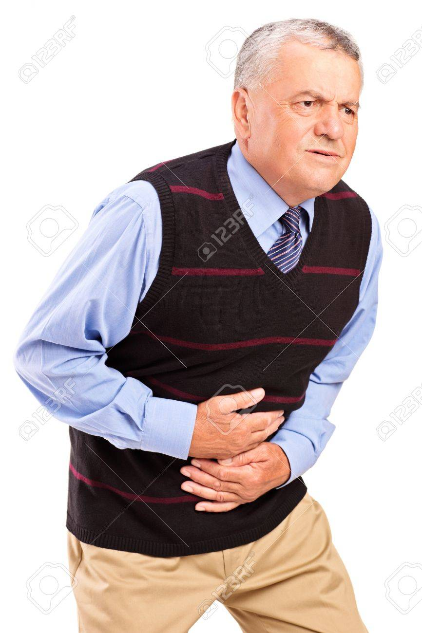 Mature man overwhelmed with a pain in the stomach isolated on white background Stock Photo - 15198696