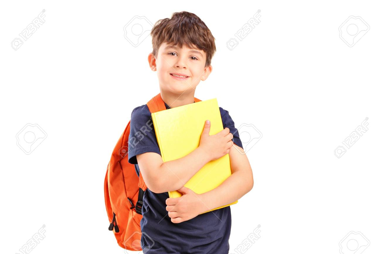 d8bdbefcd9d8 A school boy with backpack holding a notebook isolated on white background  f Stock Photo -