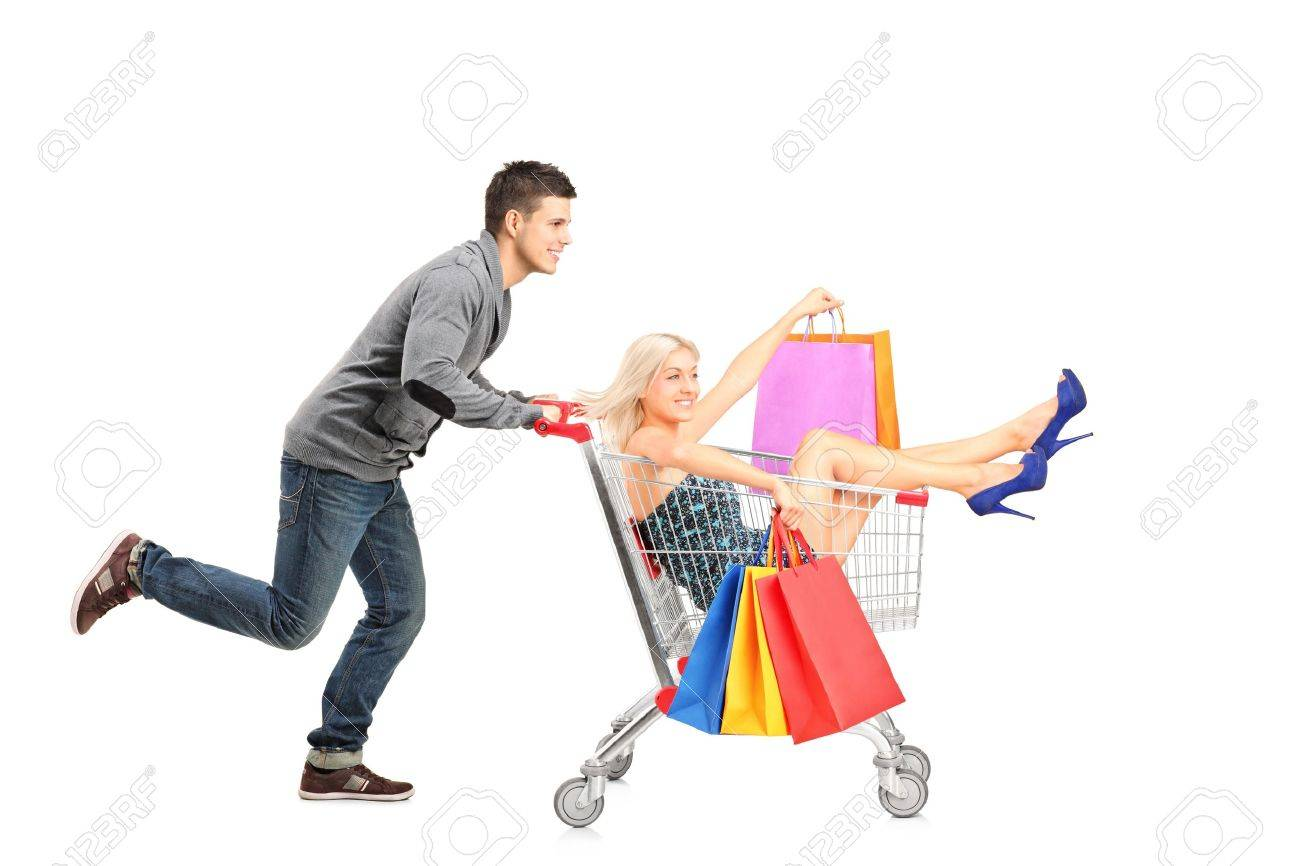 Person pushing a shopping cart, happy woman with bags in it, isolated on white background Stock Photo - 15361435