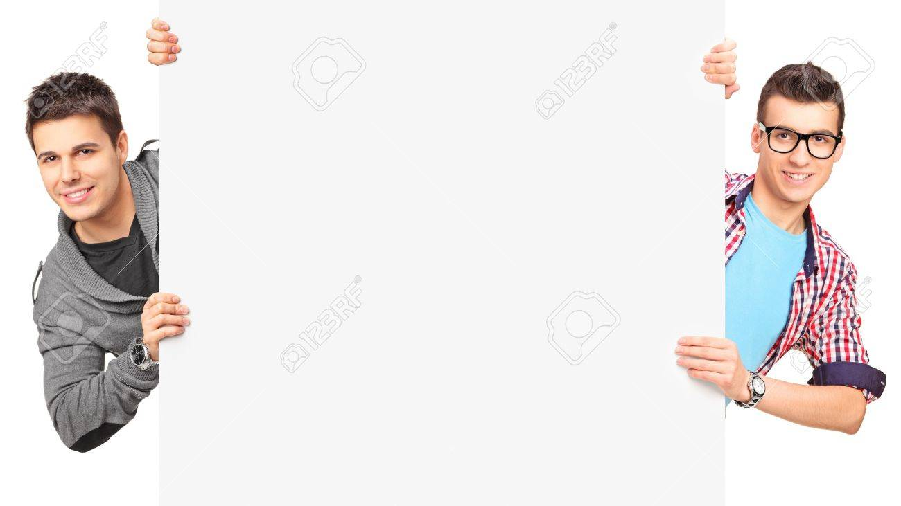 Two smiling men holding a blank panel isolated on white background Stock Photo - 15361438