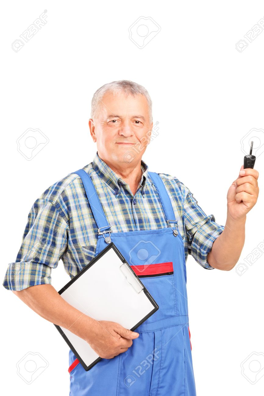 Mature mechanic in uniform holding a car key and clipboard isolated on white background Stock Photo - 15762895