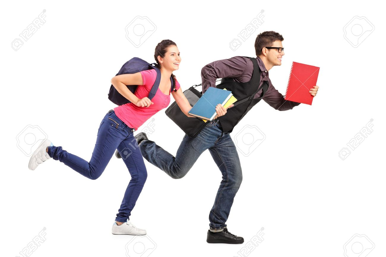 Male and female students rushing forwards with books in their hands, focus on the boy - 16012084
