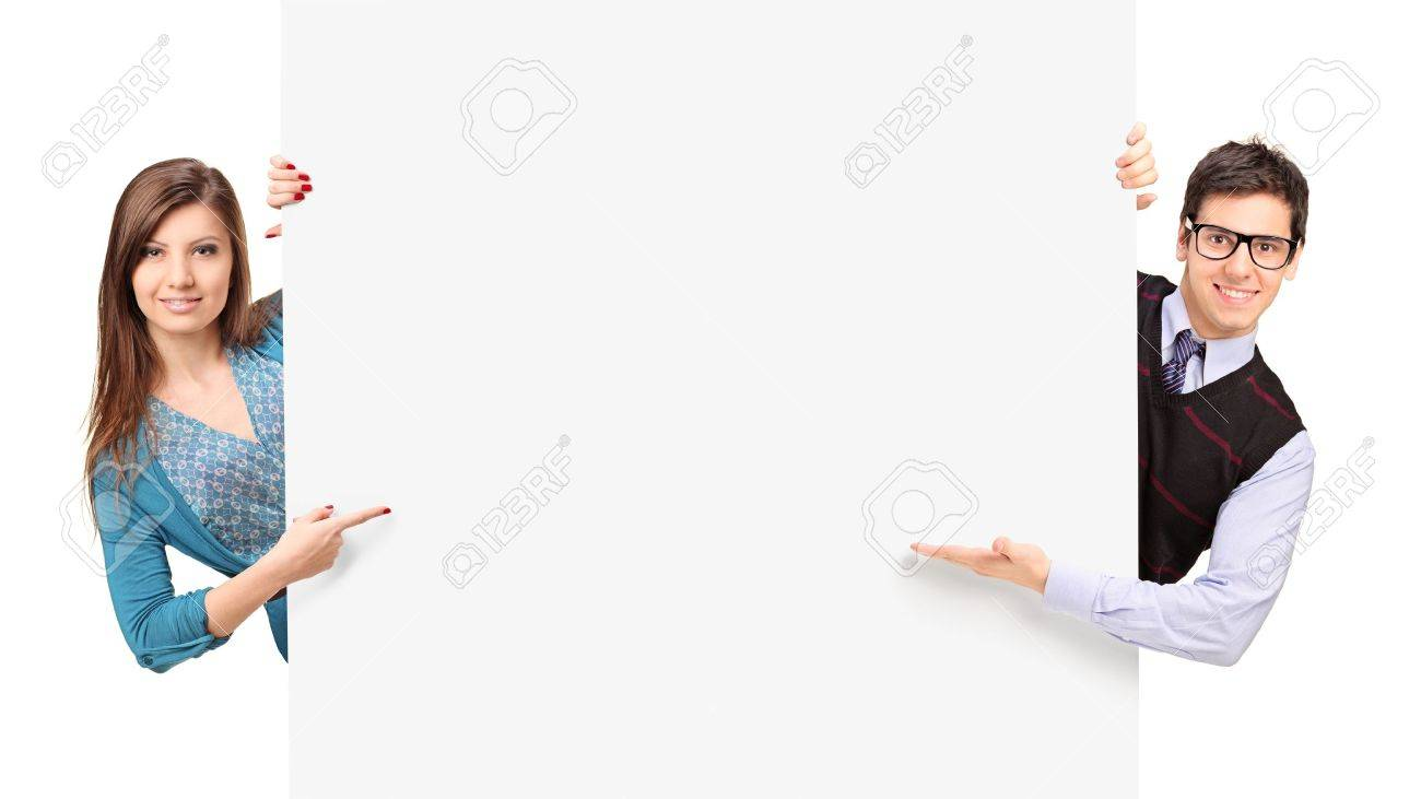 Man and female posing behind a blank panel isolated on white background Stock Photo - 16012092