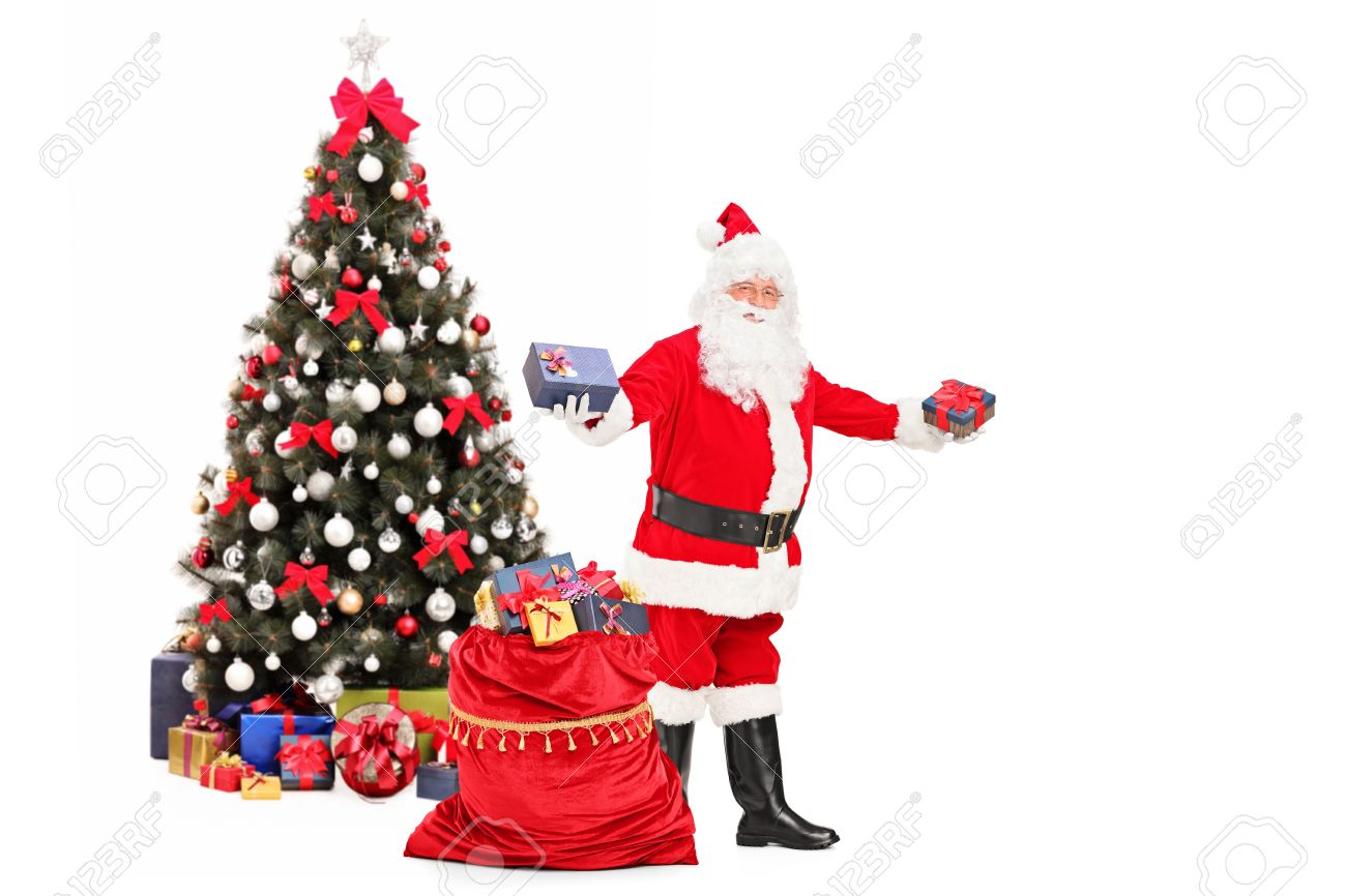 Santa claus giving gifts from a bag full of presents and decorated santa claus giving gifts from a bag full of presents and decorated christmas tree in the negle Choice Image