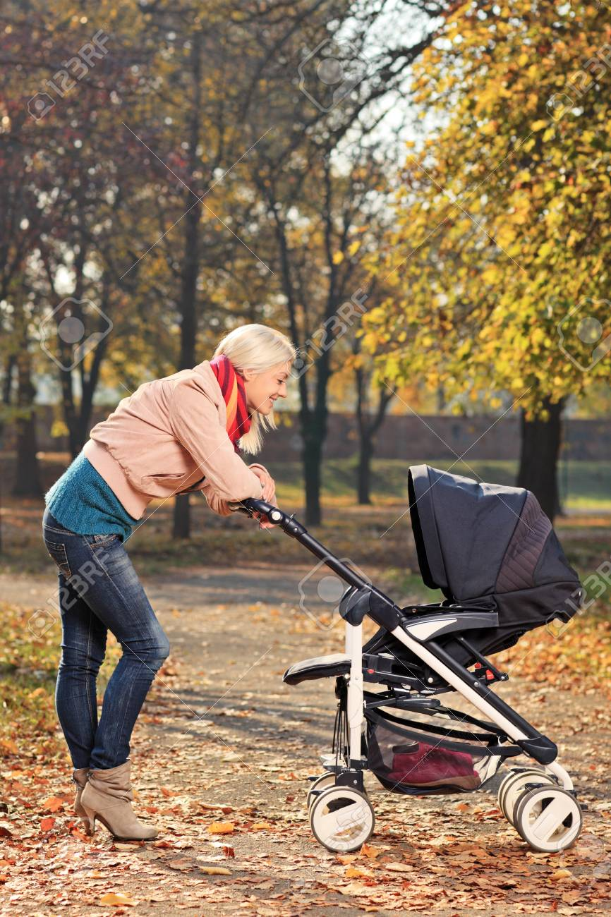 A view of a young mother looking at her baby in a stroller Stock Photo - 16502554