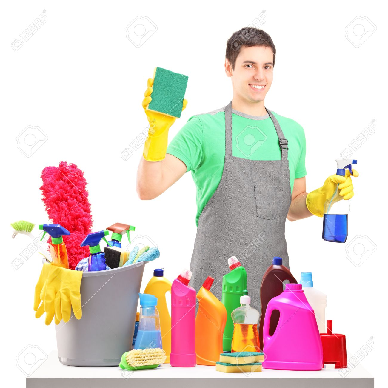 A smiling male cleaner with cleaning equipment isolated on white background - 16577924