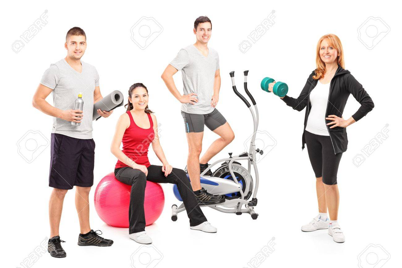 A small group of athletes posing with a fitness equipment isolated on white background Stock Photo - 17000075
