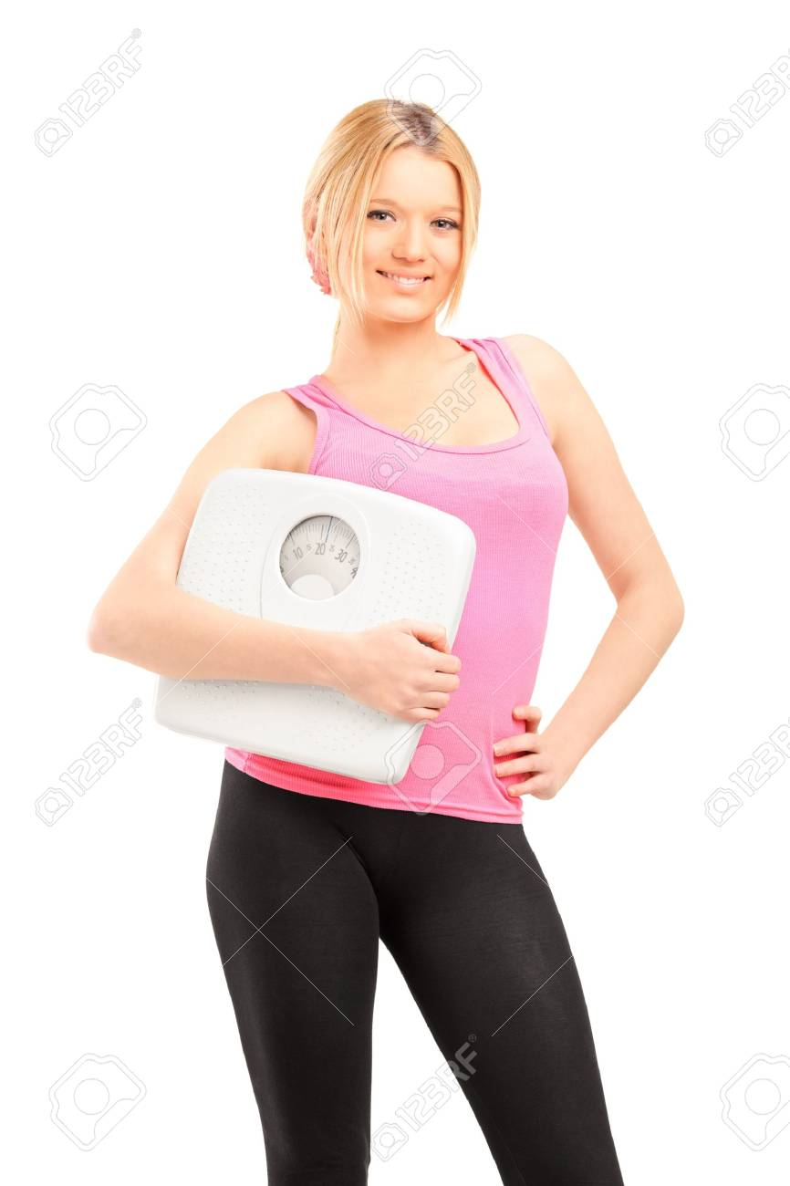 Blond smiling female athlete holding a weight scale isolated on white background Stock Photo - 17000004