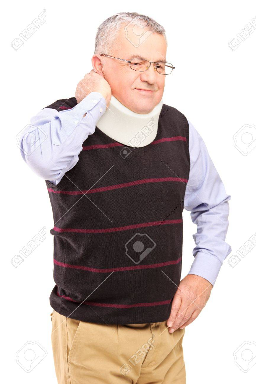 An injured mature man with neck holder suffering from a pain isolated on white background Stock Photo - 17052563