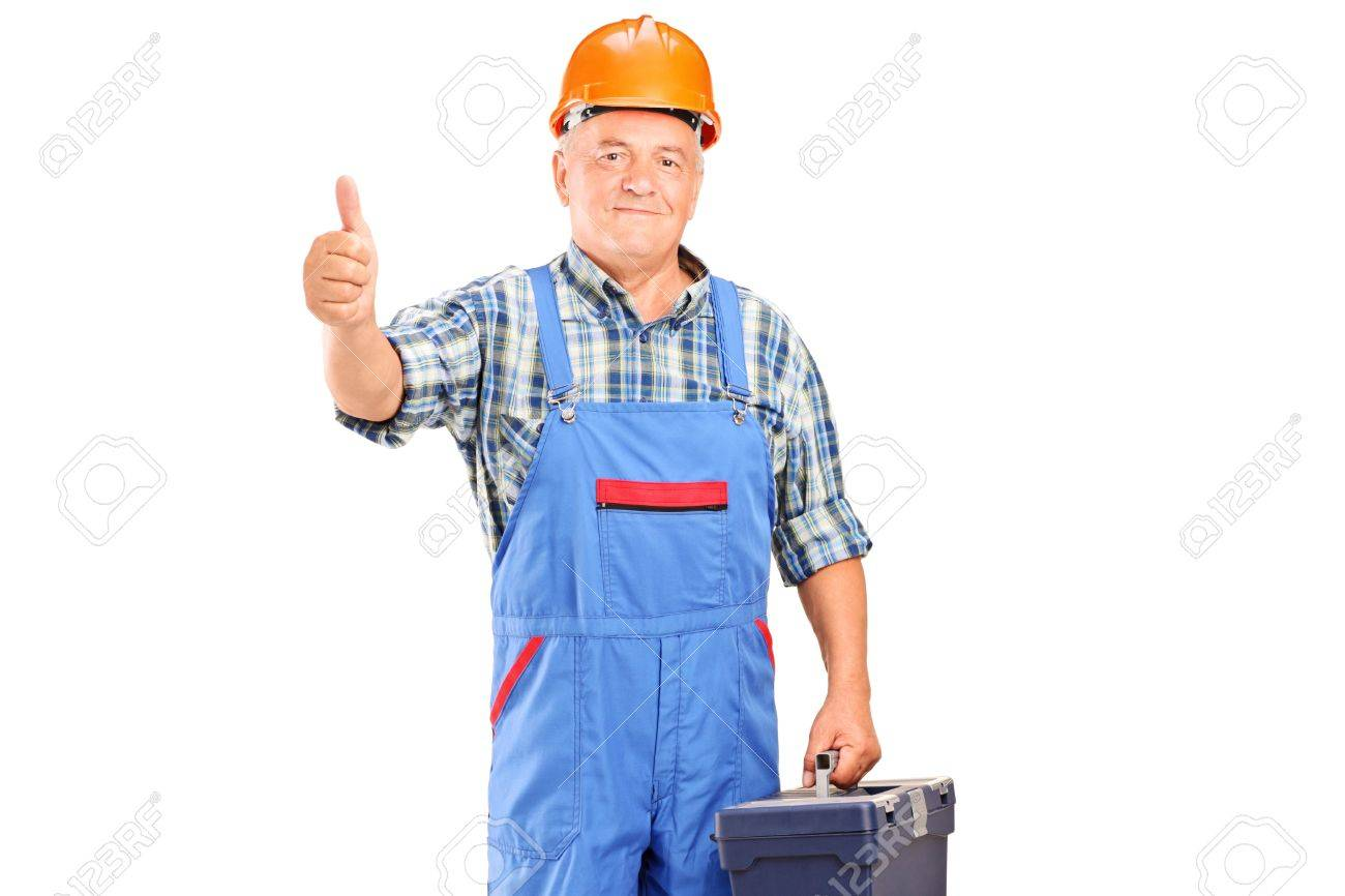 A manual worker holding tool box and giving a thumb up isolated on white background Stock Photo - 17130879