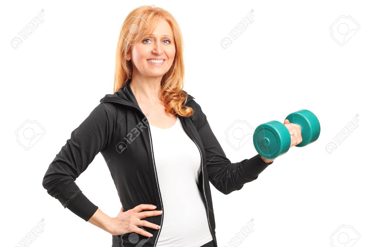 A mature woman lifting up a dumbbell isolated on white background Stock Photo - 17130841