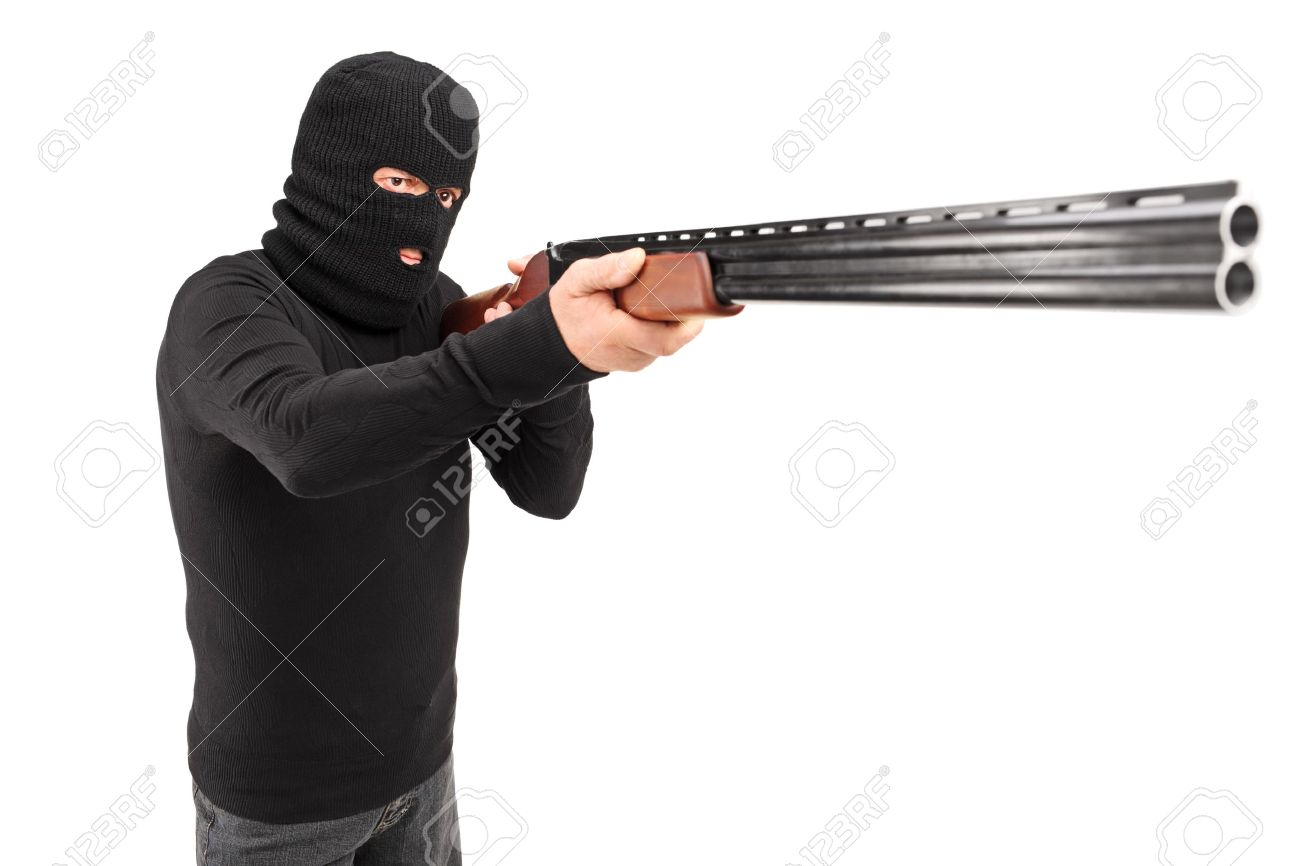 A Man With Robbery Mask Attacking Someone Shotgun Isolated On White Background Stock Photo