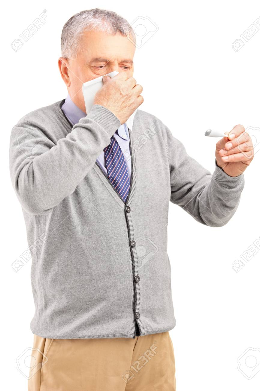 Ill senior man blowing his nose in tissue paper and looking at thermometer isolated on white background Stock Photo - 17231189