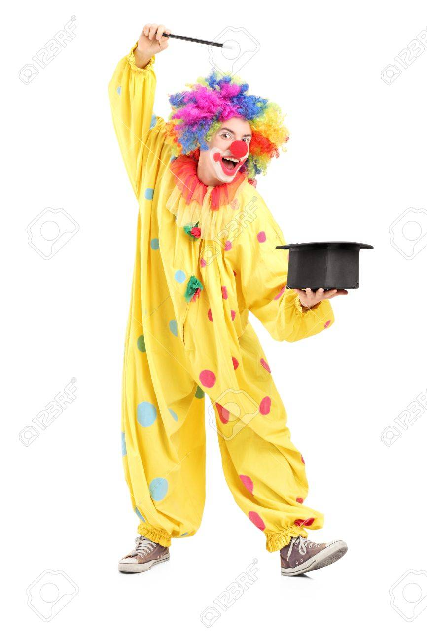 Full length portrait of a circus clown performing a magic trick isolated on white background Stock Photo - 17293543