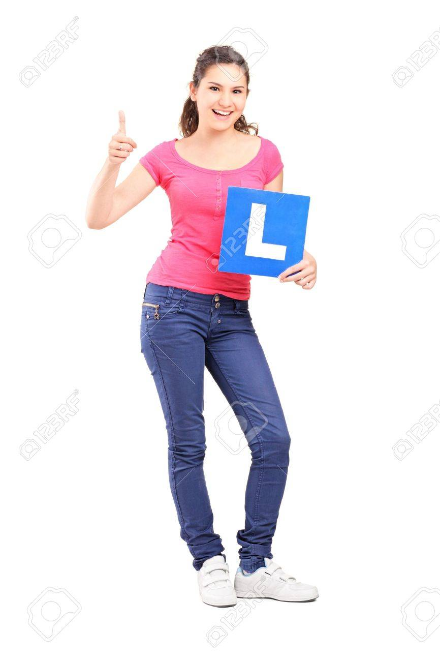 Full length portrait of a happy teenager holding L plate and giving a thumb up isolated against white background Stock Photo - 17321180