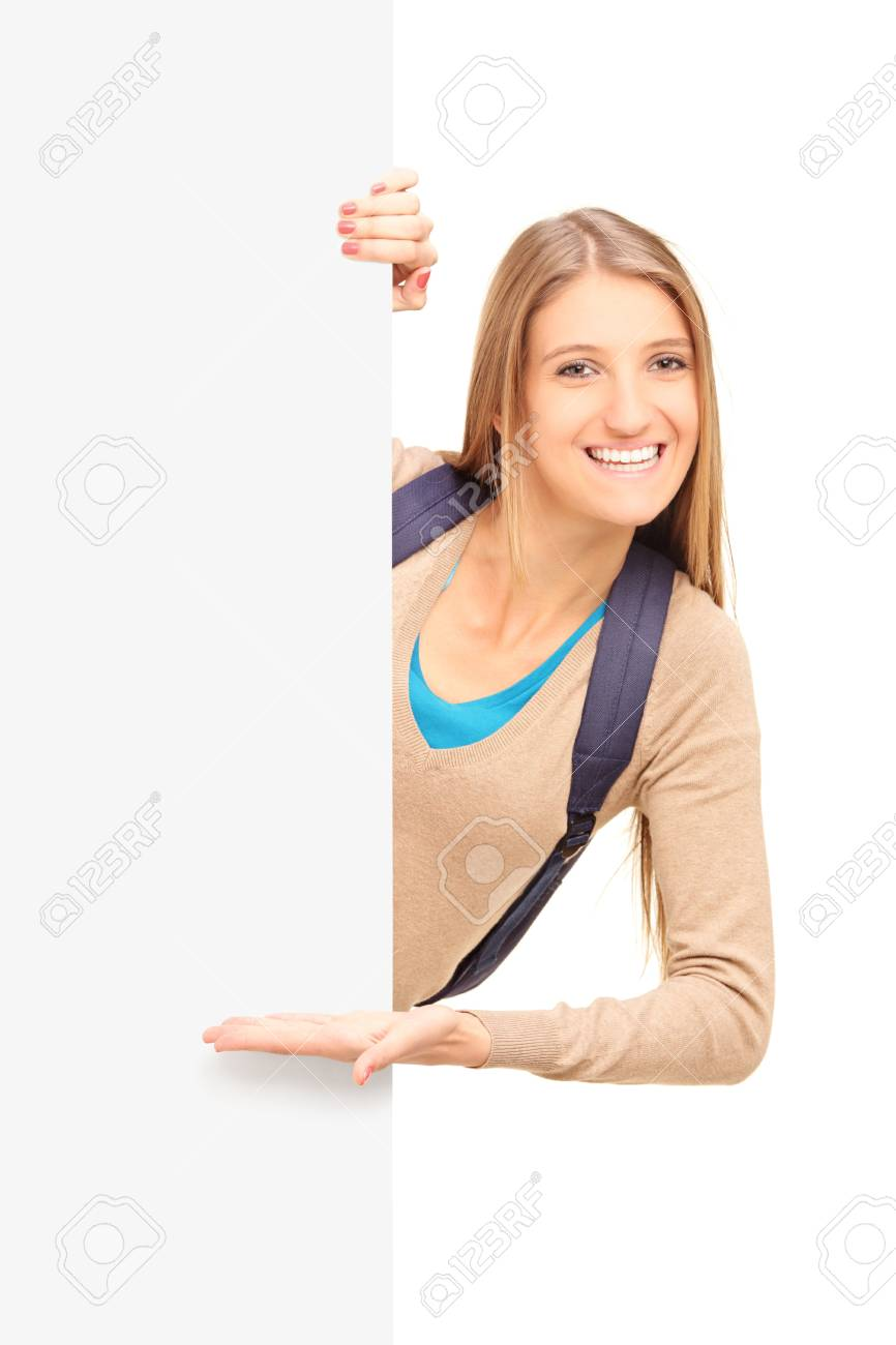 A smiling female student gesturing on a blank panel isolated on white background Stock Photo - 17333952