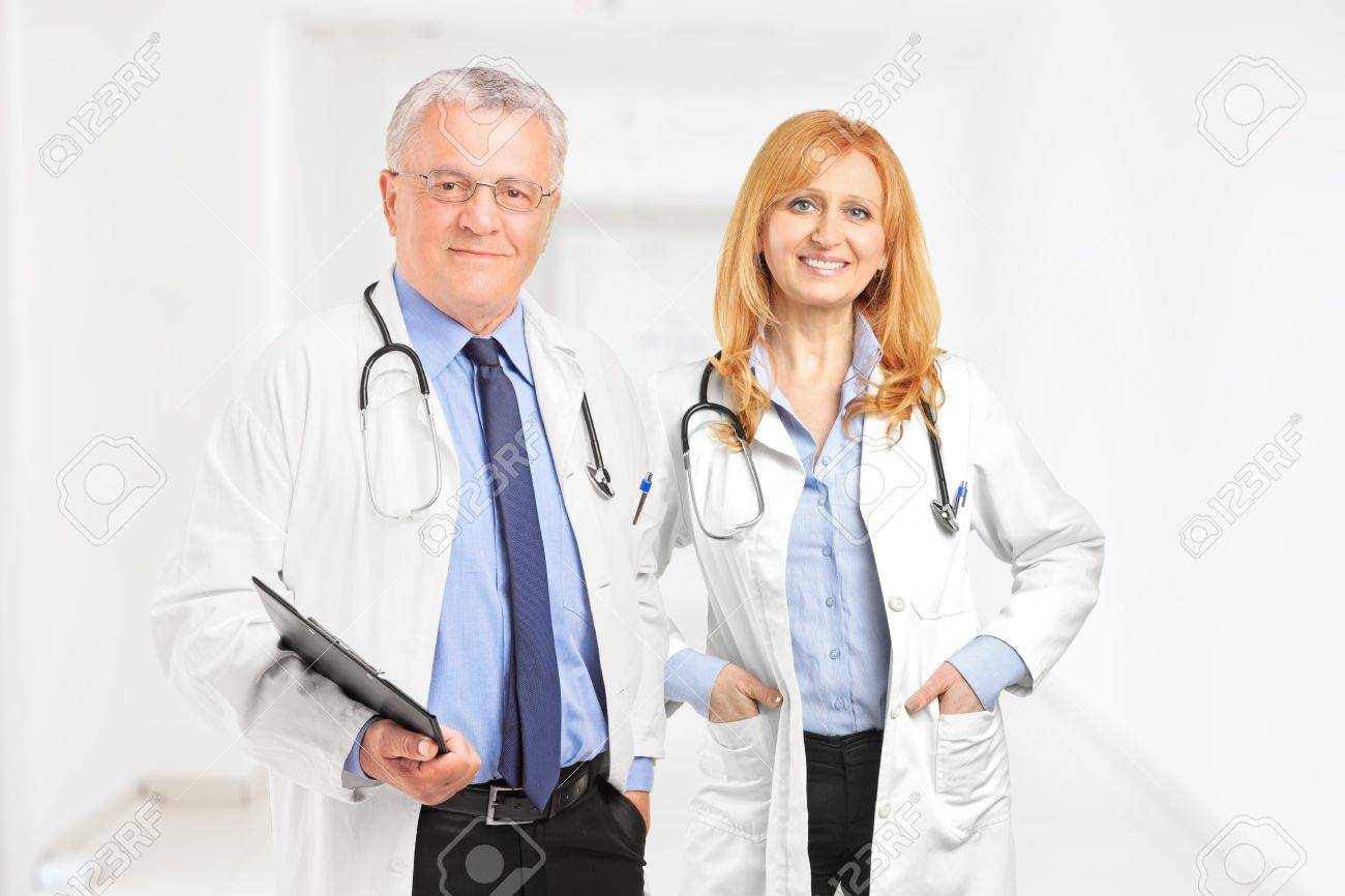 Male and female doctor standing in a hall of a clinic Stock Photo - 17506577