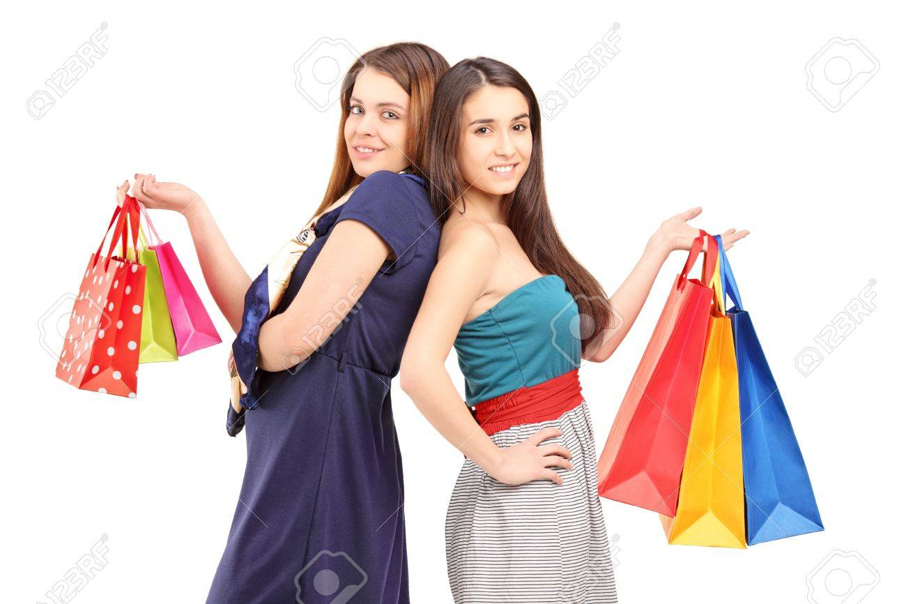 Woman posing with shopping bags isolated on white background full - Stock Photo Two Young Females After Shopping Posing With Bags Isolated On White Background