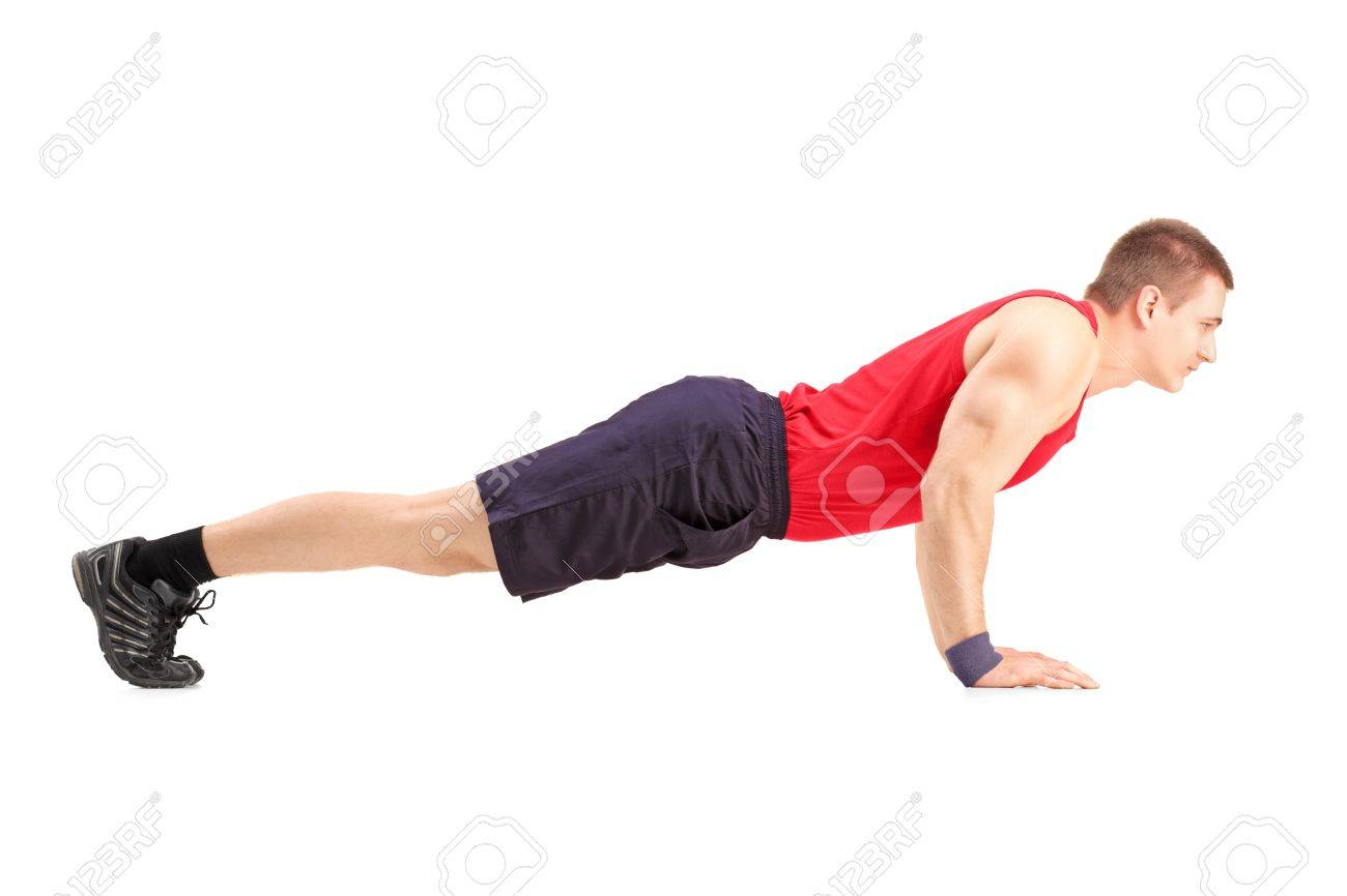Male athlete in a sportswear doing push ups isolated on white background Stock Photo - 18056821