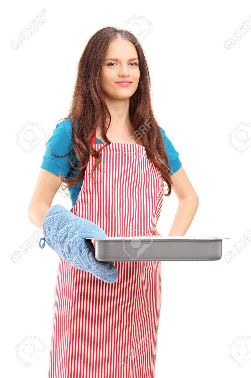 Apron woman beautiful woman with cooking mittens and apron holding a baking tray isolated on