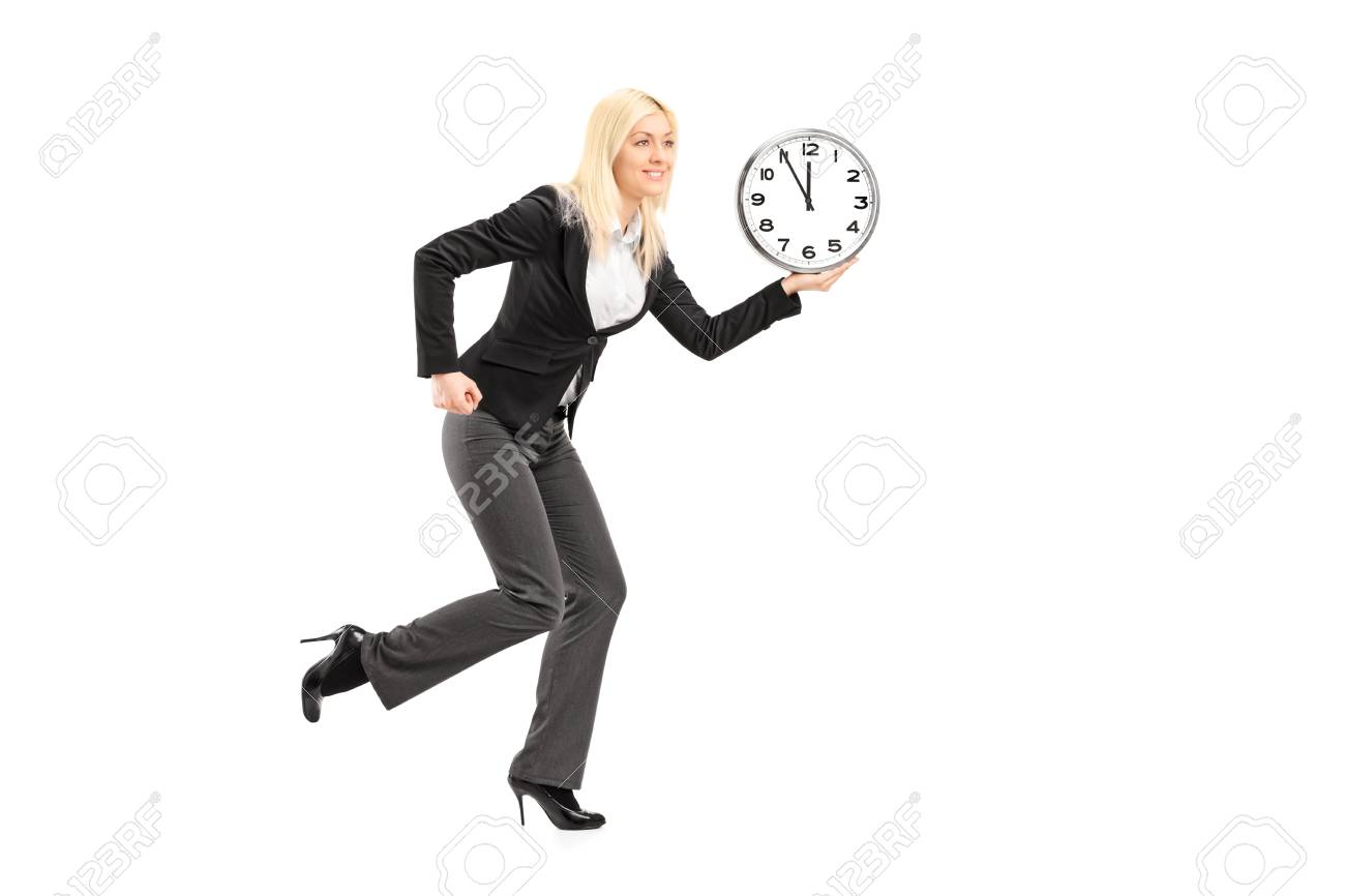 Full length portrait of a businesswoman running with clock isolated on white background Stock Photo - 18751116