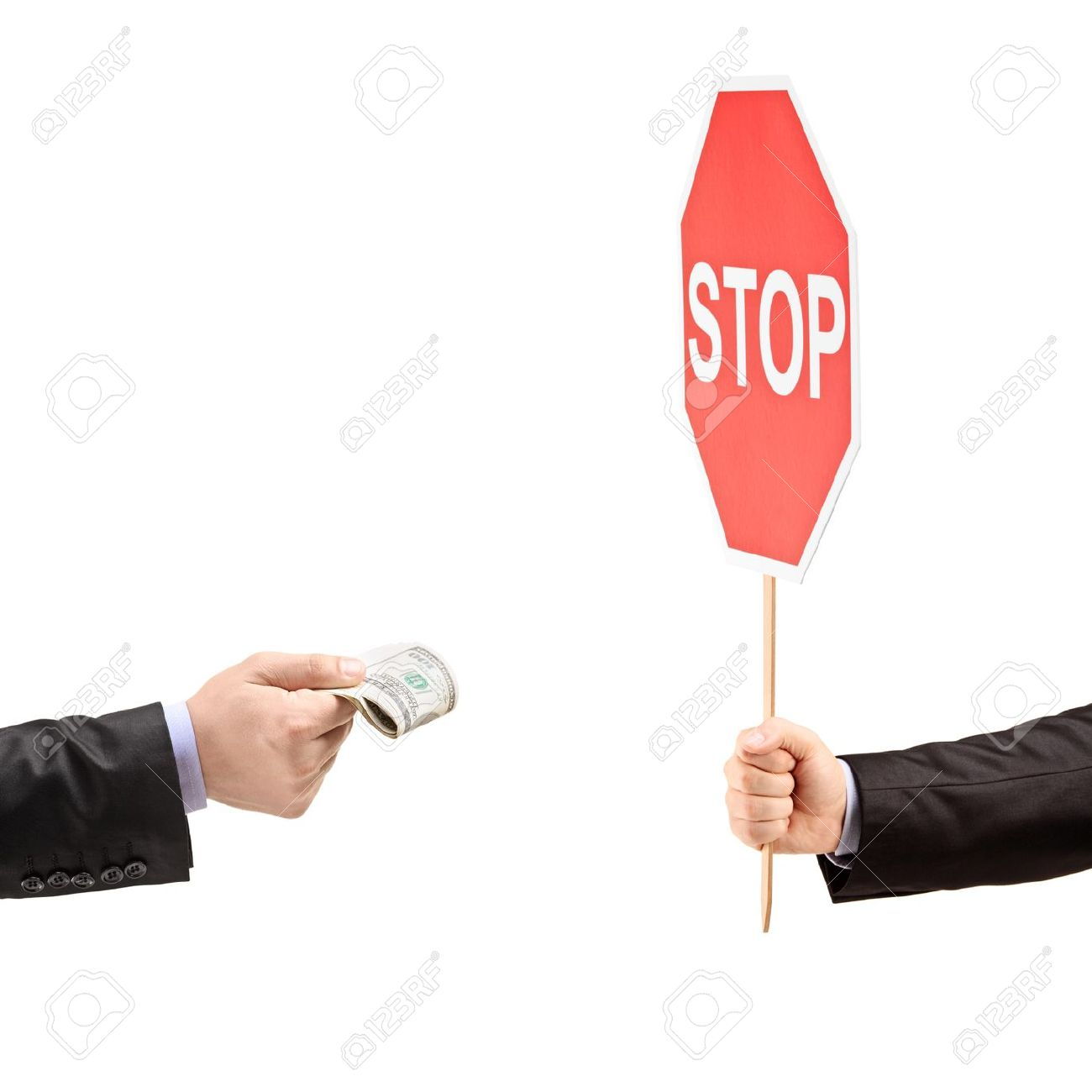 Man with a stop sign saying no to bribery, isolated on white background Stock Photo - 19211800