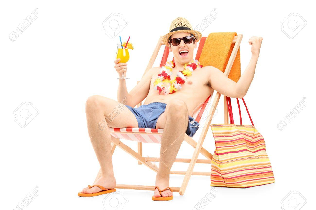 Happy Young Man Enjoying A Cocktail And Sitting On A Beach Chair Stock Photo Picture And Royalty Free Image Image 19662054