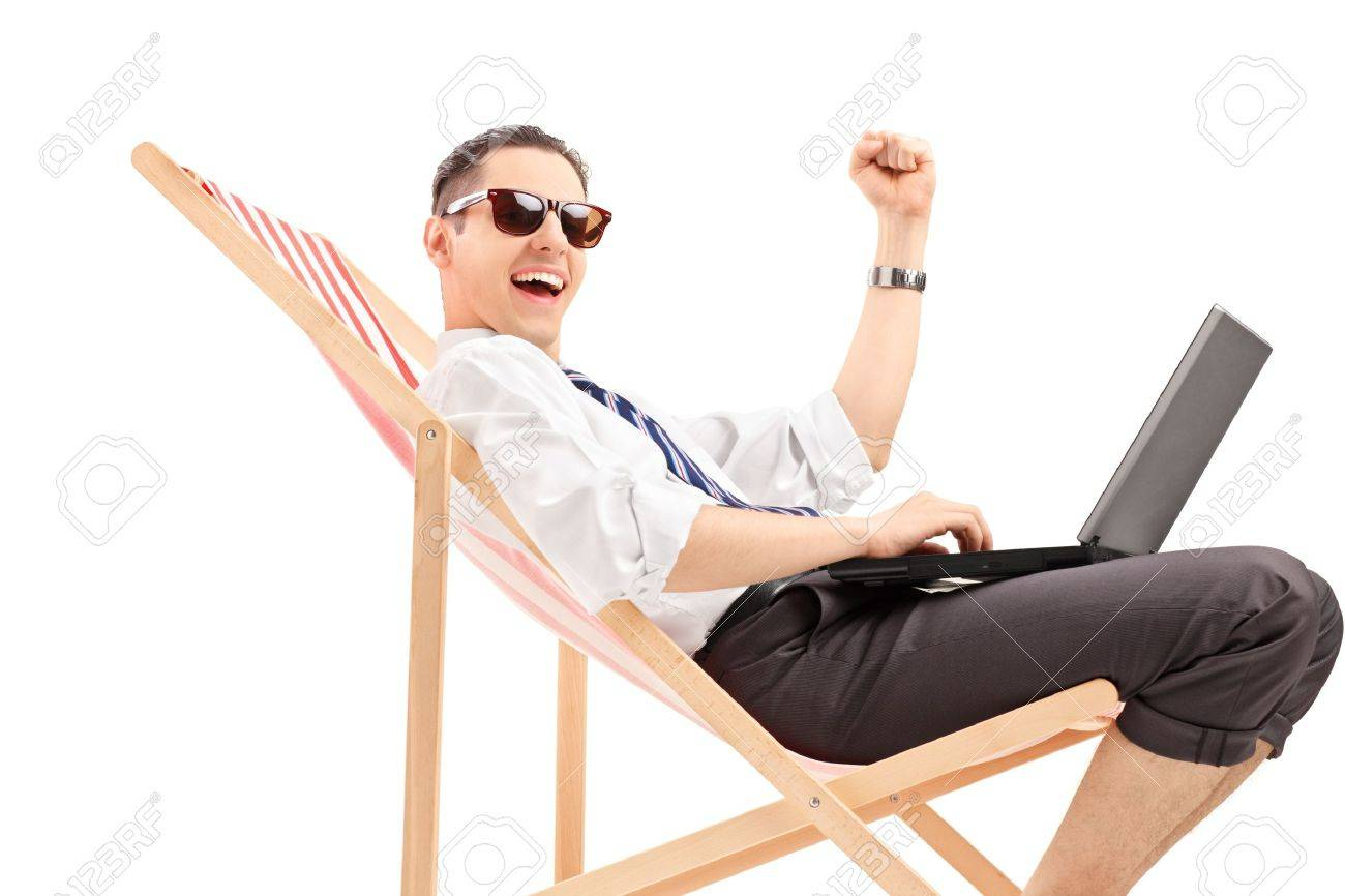 Young Professional Man Sitting On A Beach Chair With A Laptop Stock Photo Picture And Royalty Free Image Image 20370166