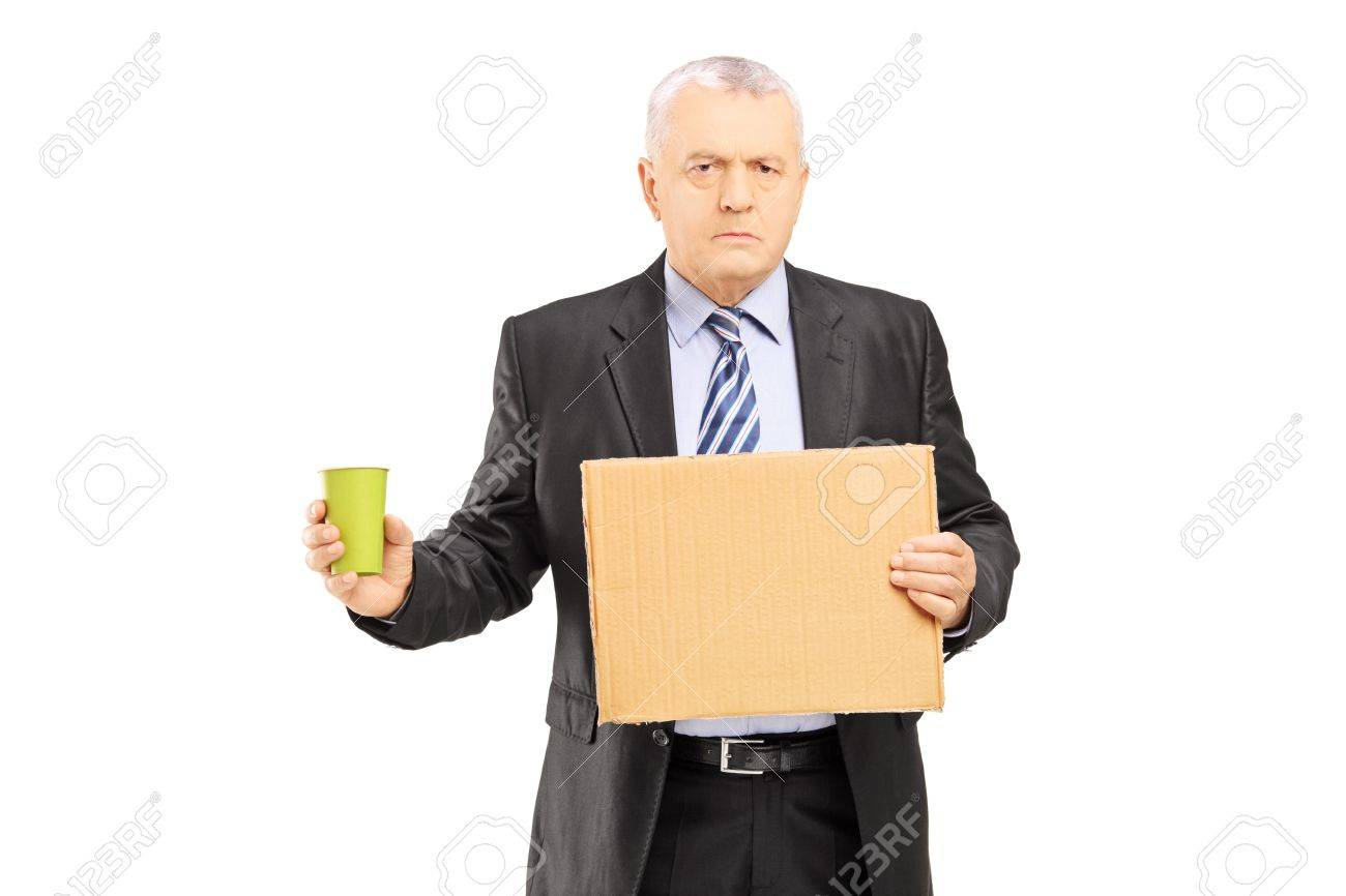 Bankrupted mature businessman holding a piece of cardboard and cup begging, isolated on white background - 20633977