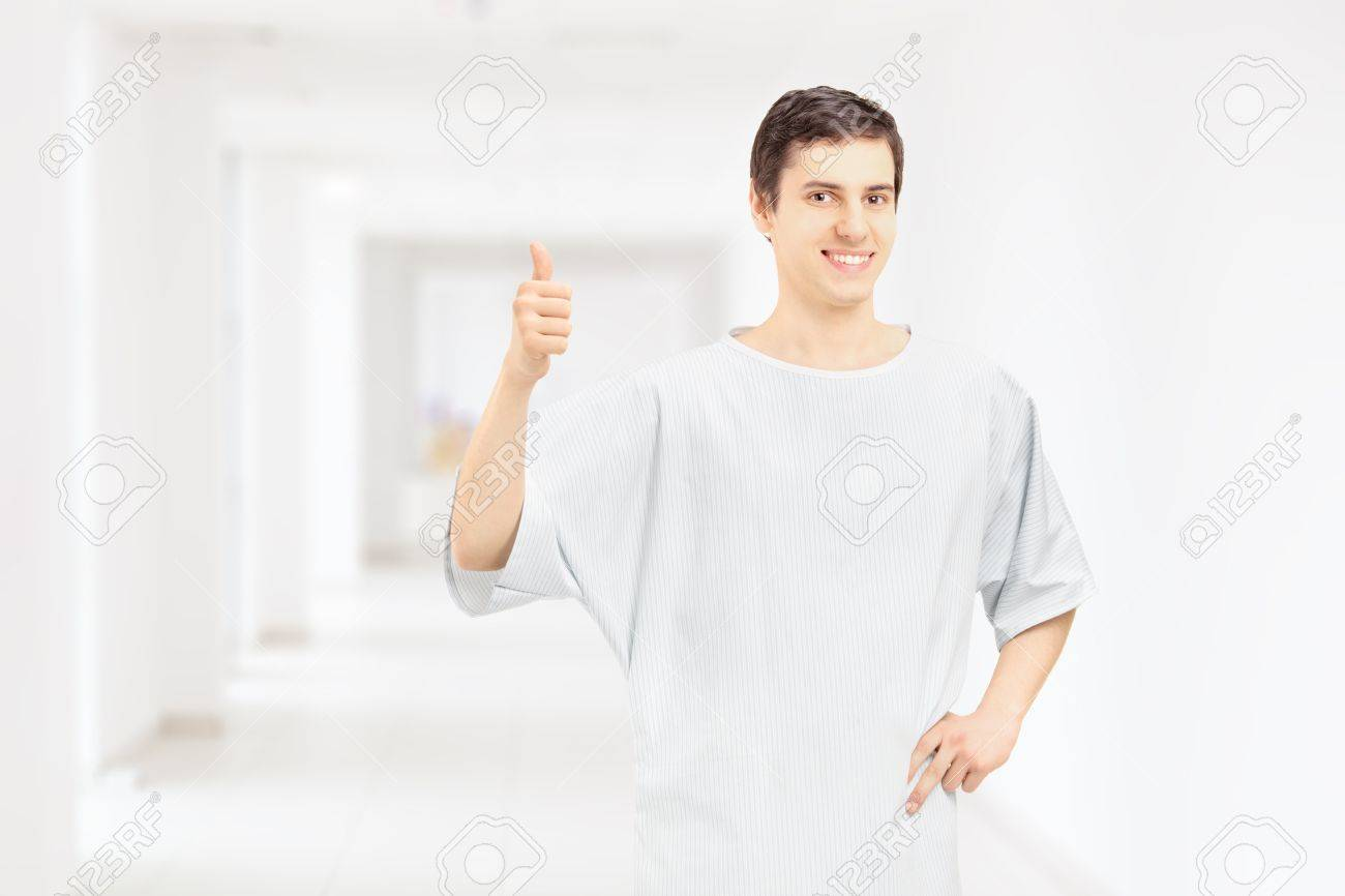 Smiling Male Patient Wearing Hospital Gown And Giving Thumb Up ...